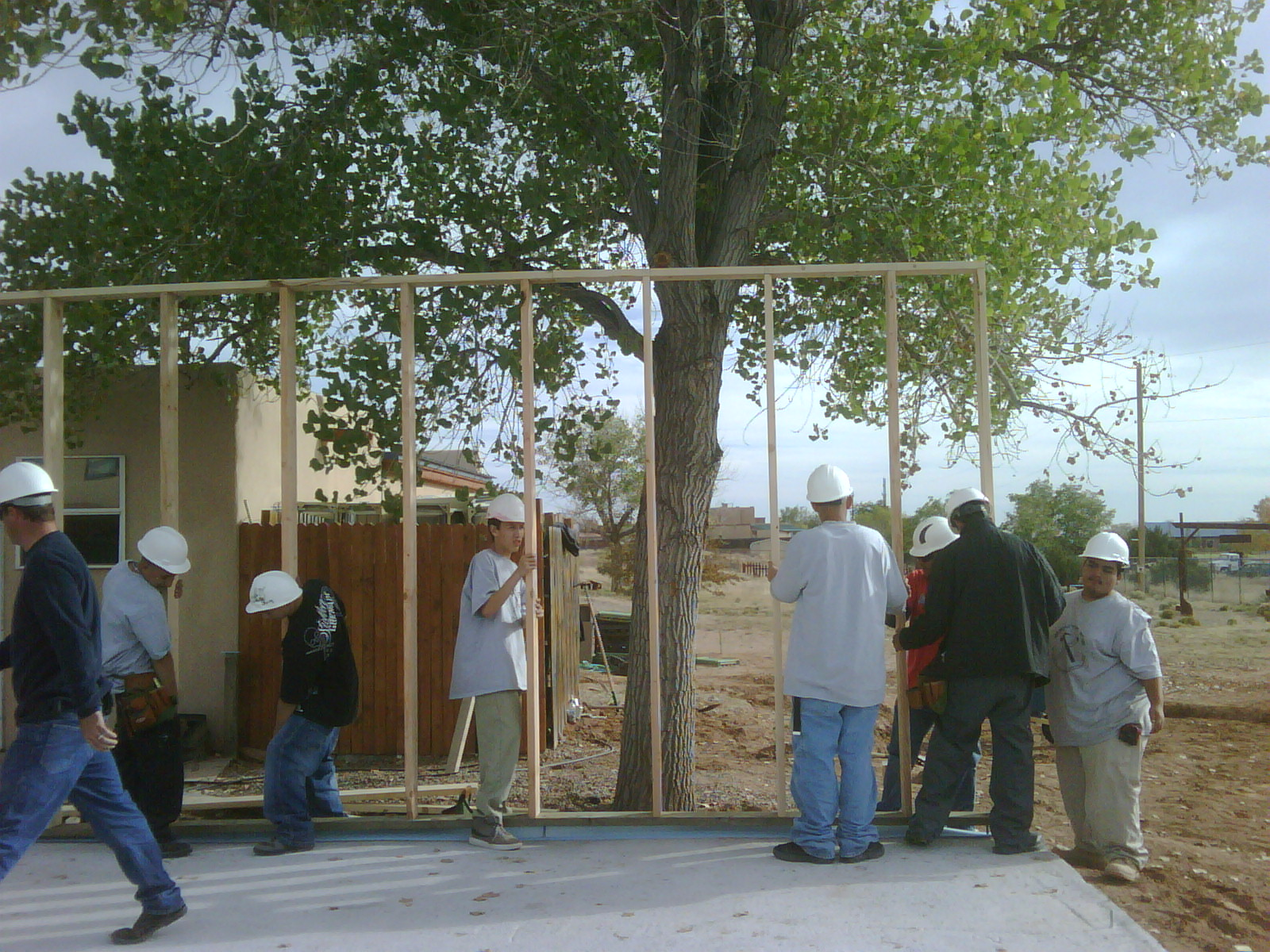 YouthBuild crew works on framing house they're building with Habitat for Humanity.