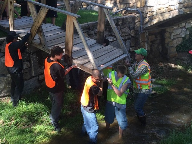 River restoration crew installs bridge over Santa Fe River.