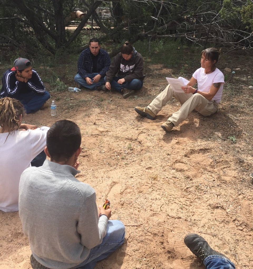 The !YouthWorks¡ Conservation Corps attends class in an outdoor setting.