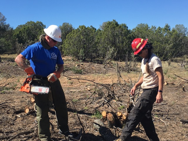 Sean works with Wildfire Network leader Krys Nystrom clearing land to protect against wildfires.